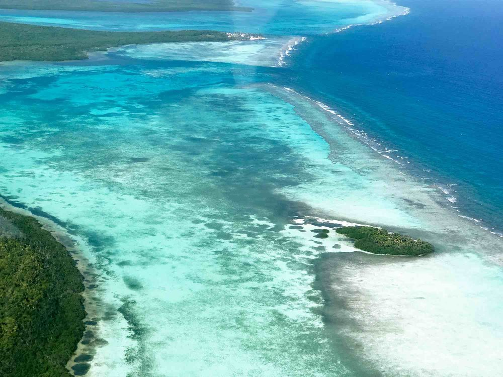 Caribbean ocean | Flying over the Great Blue Hole, Belize