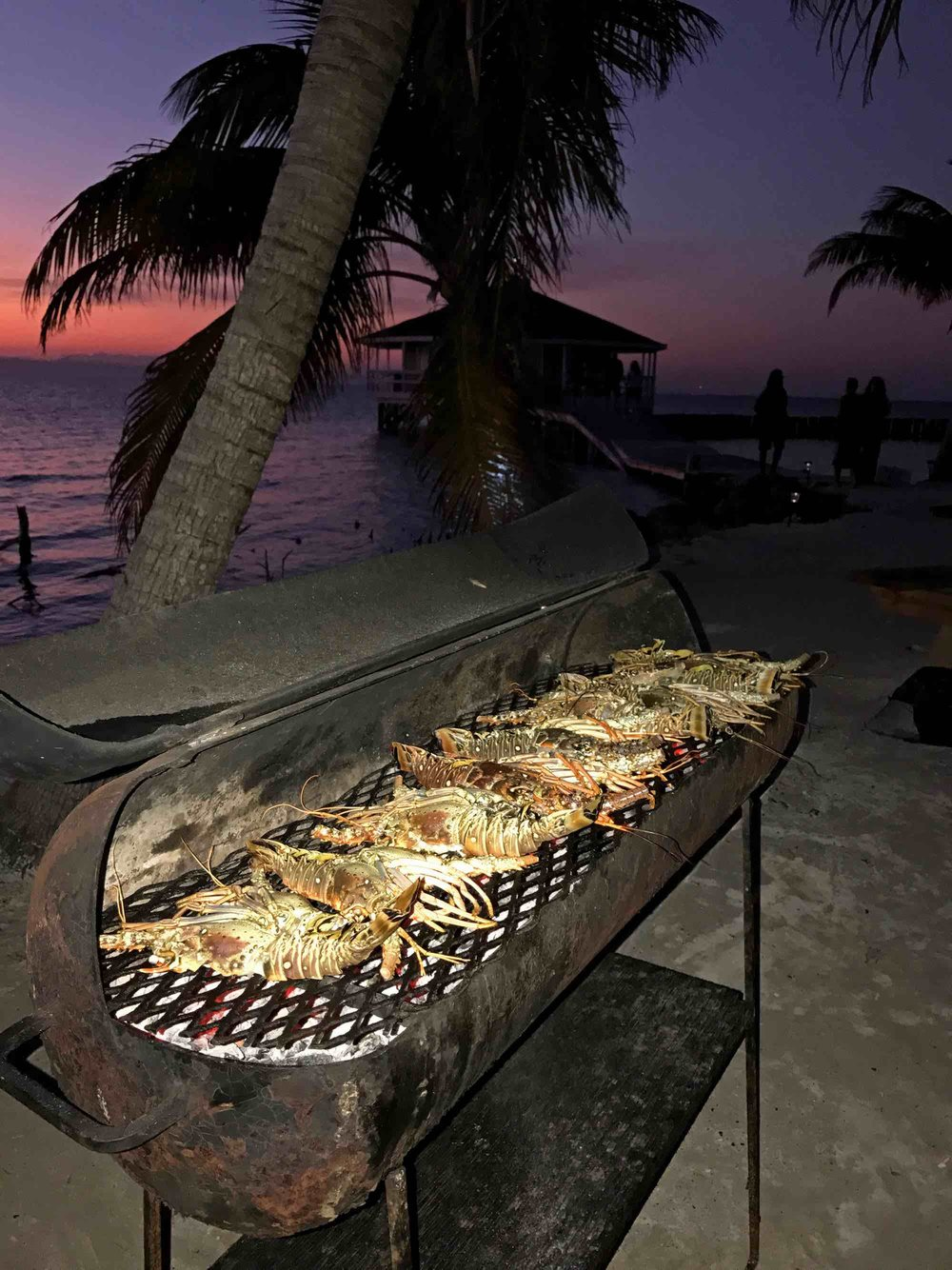 sunset lobster BBQ on Ragga Caye while sailing in Belize