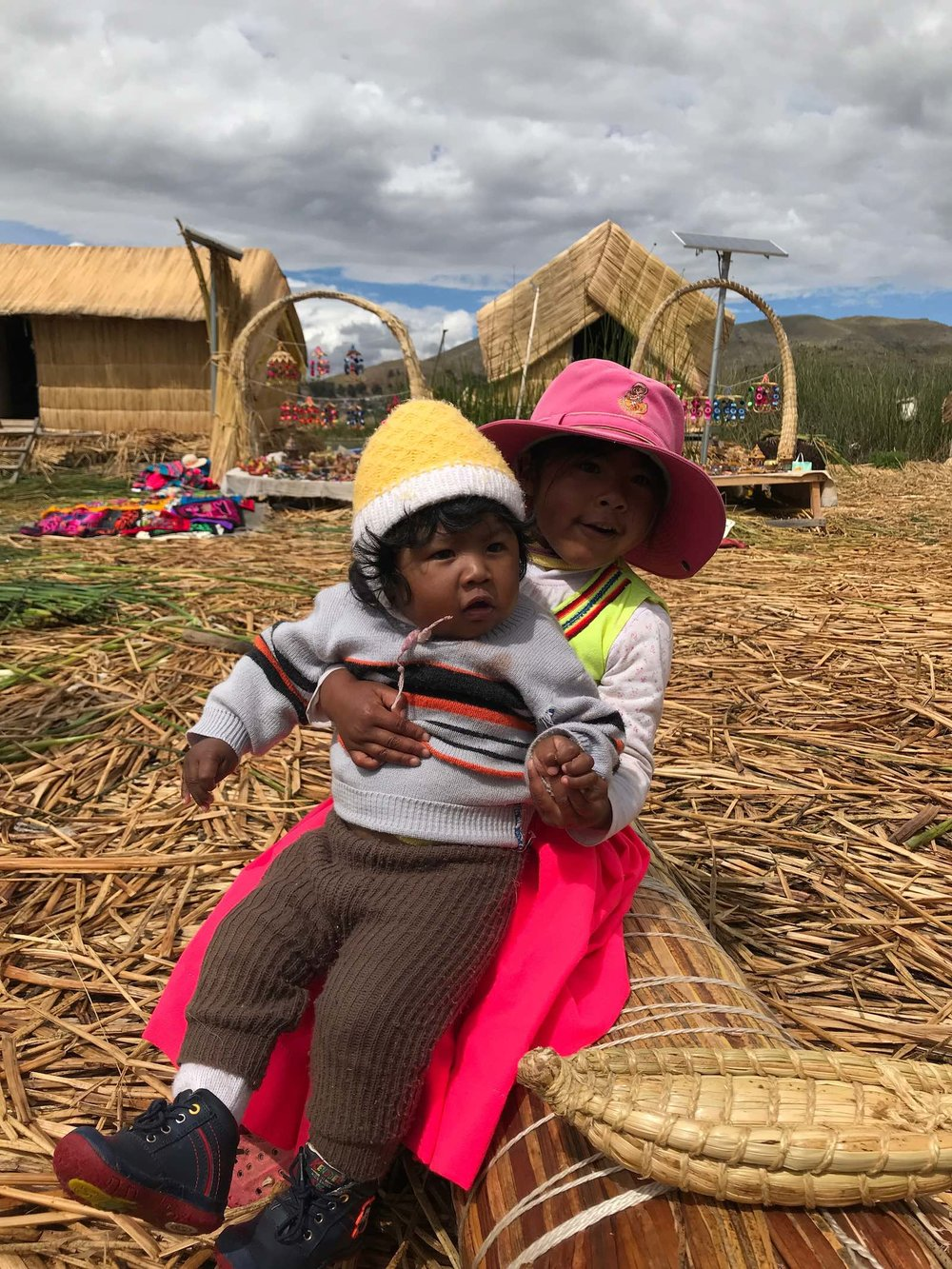 Floating Islands Lake Titicaca Peru kids