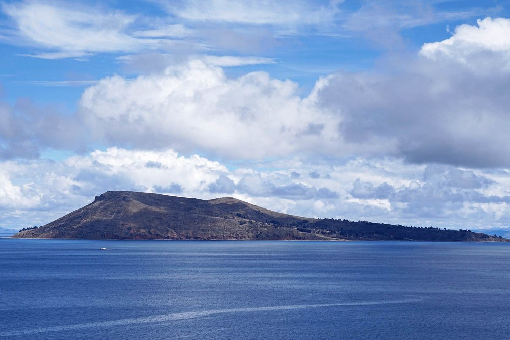 amantani island on Lake titicaca as seen from taquile island.