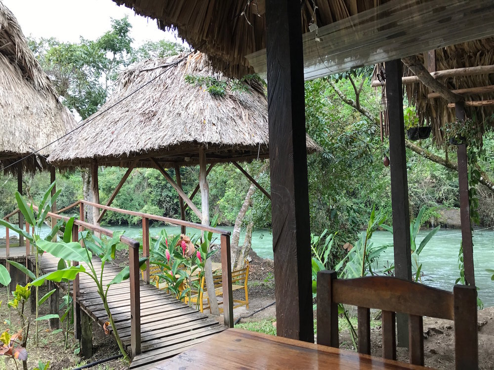 View of the river from the long communal dining tables in lanquin guatemala near semuc champey