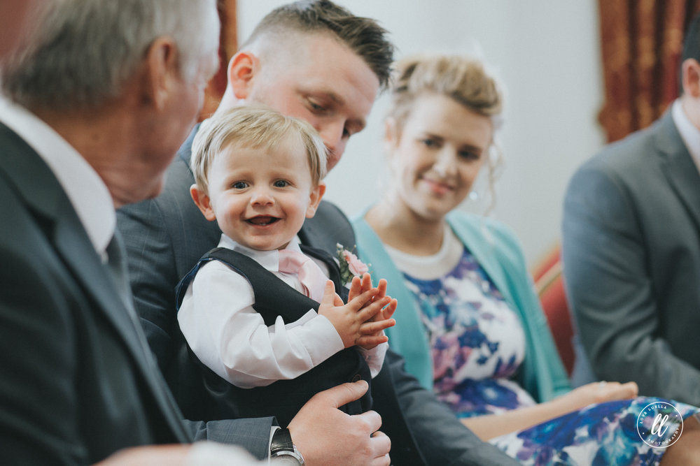 Bride and Grooms son enjoying the attention at his parents wedding