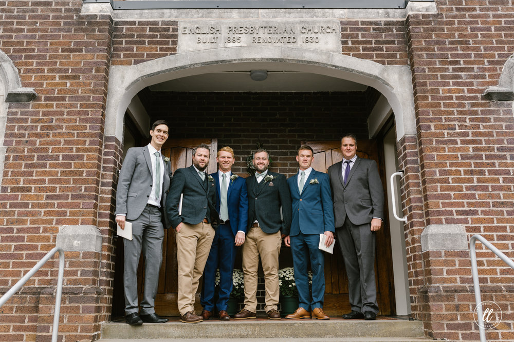 racing green groomsmen suits