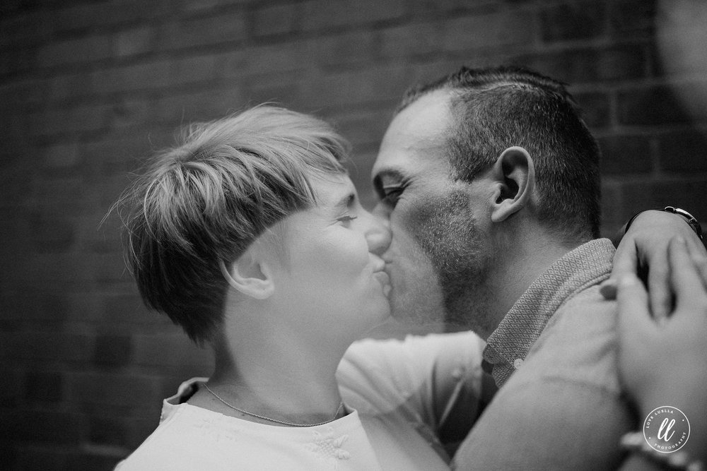 couple kissing in northern quarter-manchester