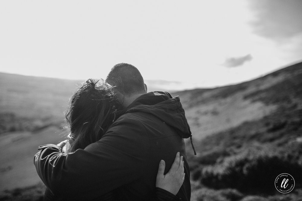 couple embracing north wales