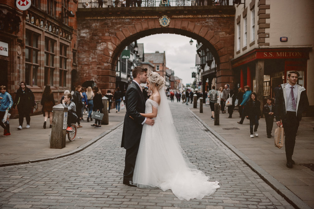 Newlywed couple kissing in Chester City Centre by Love Luella Photography