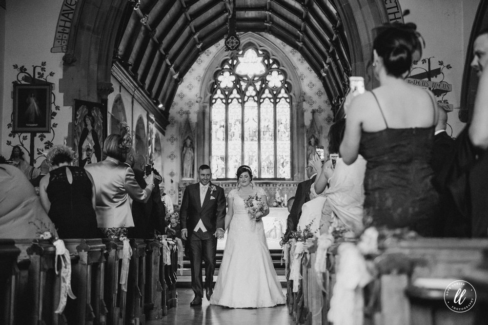 The new Mr and Mrs Jones begin their exit from Pantasaph Friary