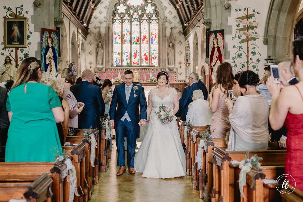 Walking up the aisle as Mr and Mrs jones