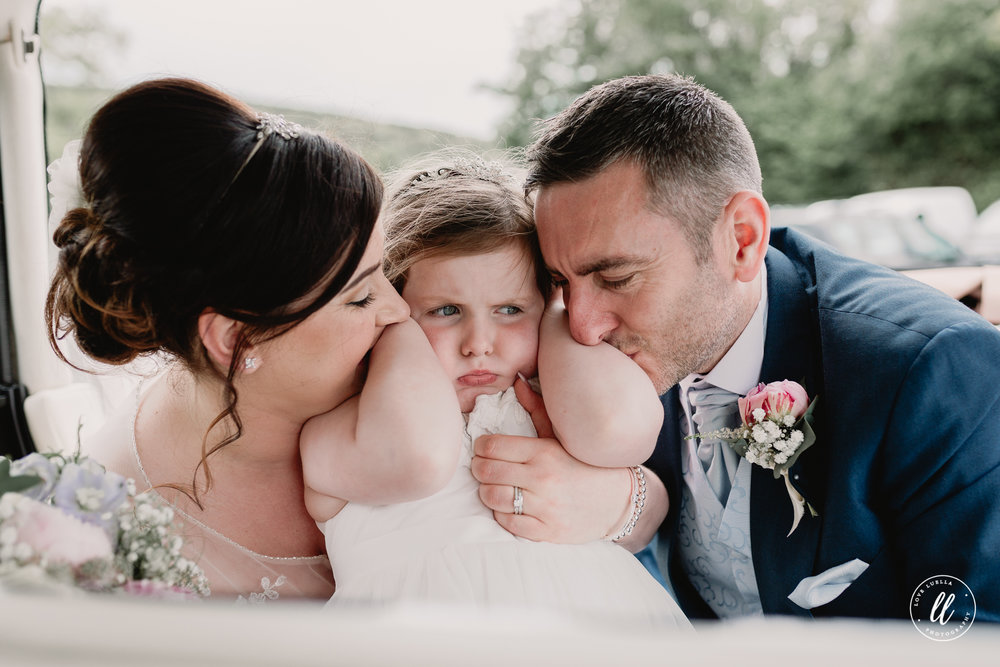 A funny moment of the Bride, Groom and their daughter