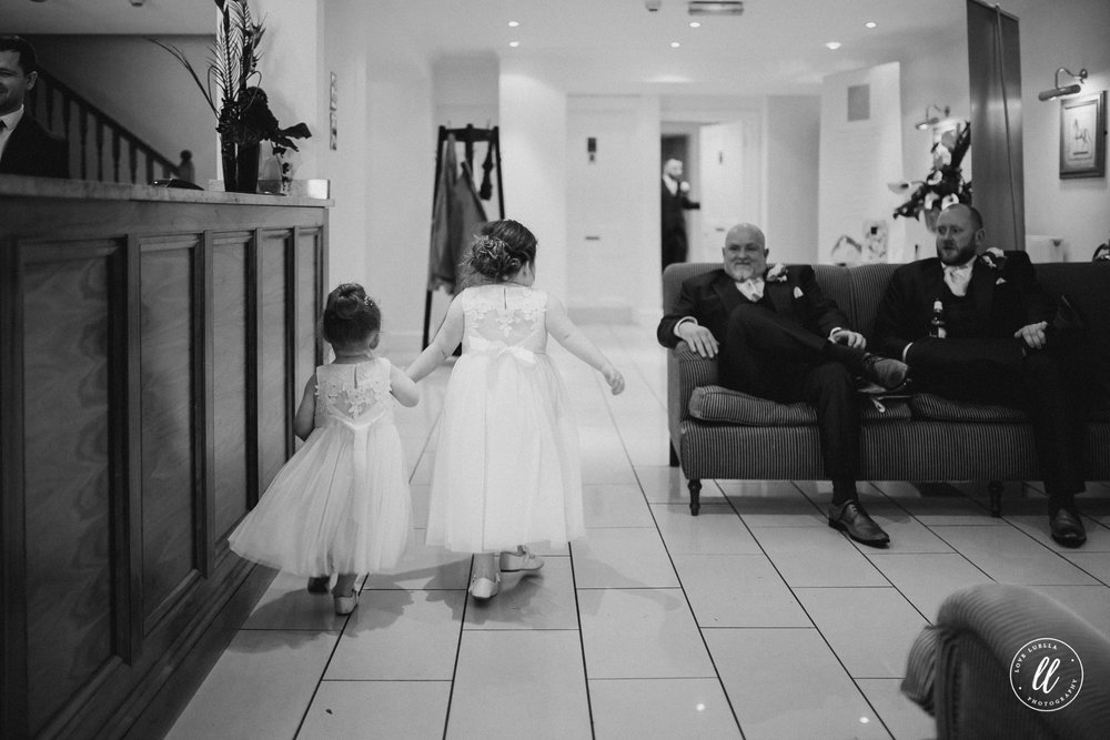 Flower Girls running through the reception room at The Kinmel