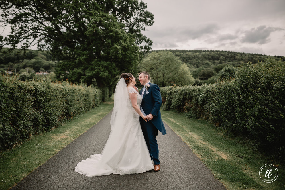 laughter between the new mr and mrs on the country lanes of abergele