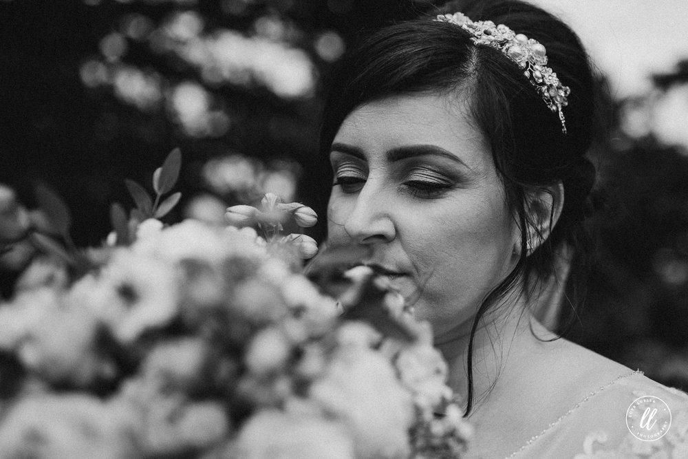 The bride smelling her flowers