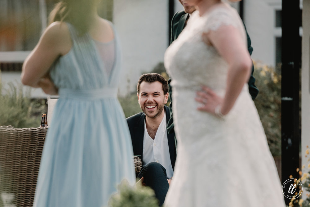 A candid image of one of the guests laughing at a good joke