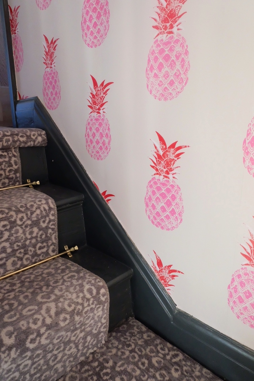 Pineapple print and snow leopard hallway
