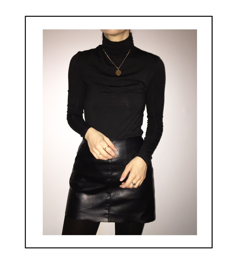 black outfit - leather skirt and polo neck top