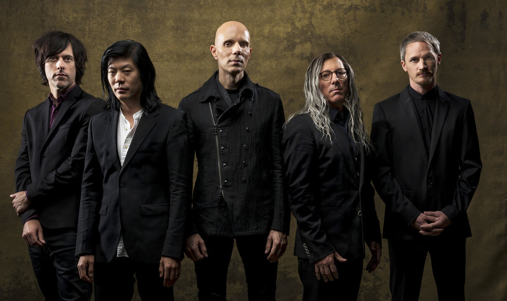 """Photo Credit: Tim Cadiente  Los Angeles –Feb. 5, 2018 – A Perfect Circle release  Eat The Elephant , the band's fourth full-length album and first since 2004's  eMOTIVe , on April 20 via BMG.  The album arrives following years of anticipation and speculation, which reached a fever pitch as the outfit helmed by Maynard James Keenan and Billy Howerdel launched their Fall 2017 tour with the release of """"The Doomed"""" ( http://smarturl.it/TheDoomedVideo ). The band then ushered in the new year with the debut of the contemplative song, """"Disillusioned"""" ( http://smarturl.it/DisillusionedYT ).  """"Although I'm extremely excited to finally be completing this album after a 14-year hiatus,"""" explains Keenan. """"I'm actually more excited that its intentional release date is serving a greater purpose. The 20th of April is Carina Round's birthday. She is a dear friend who is extremely difficult to shop for. Pressure off. Of course, I must also note that the potheads are gonna be thrilled that this album comes out on 4-20. May it serve as a glorious soundtrack to accompany all of the giggling and vexing sounds of nibbling and snacking. Fingers crossed, Cheech & Chong will be proud.""""  """"Demos are these precious ideas that you love in their initial state,"""" adds Howerdel. """"Then you collaborate, invite other ideas, and watch them progress. That's the dynamics and growth of a great record. I feel we've made a great record.""""  Pre-orders for the 12-song album, which was co-produced by Dave Sardy (Autolux, Slayer), are available now ( https://AperfectCircle.lnk.to/EatTheElephantPR ) and come with instant digital downloads of """"TalkTalk"""" ( http://smarturl.it/TalkTalkVEVO ), """"Disillusioned"""" and """"The Doomed."""" Eat The Elephant is being released in multiple formats including digital, CD, double gatefold 180-gram vinyl and a box set with vinyl, CD and hi-res digital download as well as a prism and custom playing card deck. In advance of Record Store Day, a limited-edition independent retail exclusivevers"""