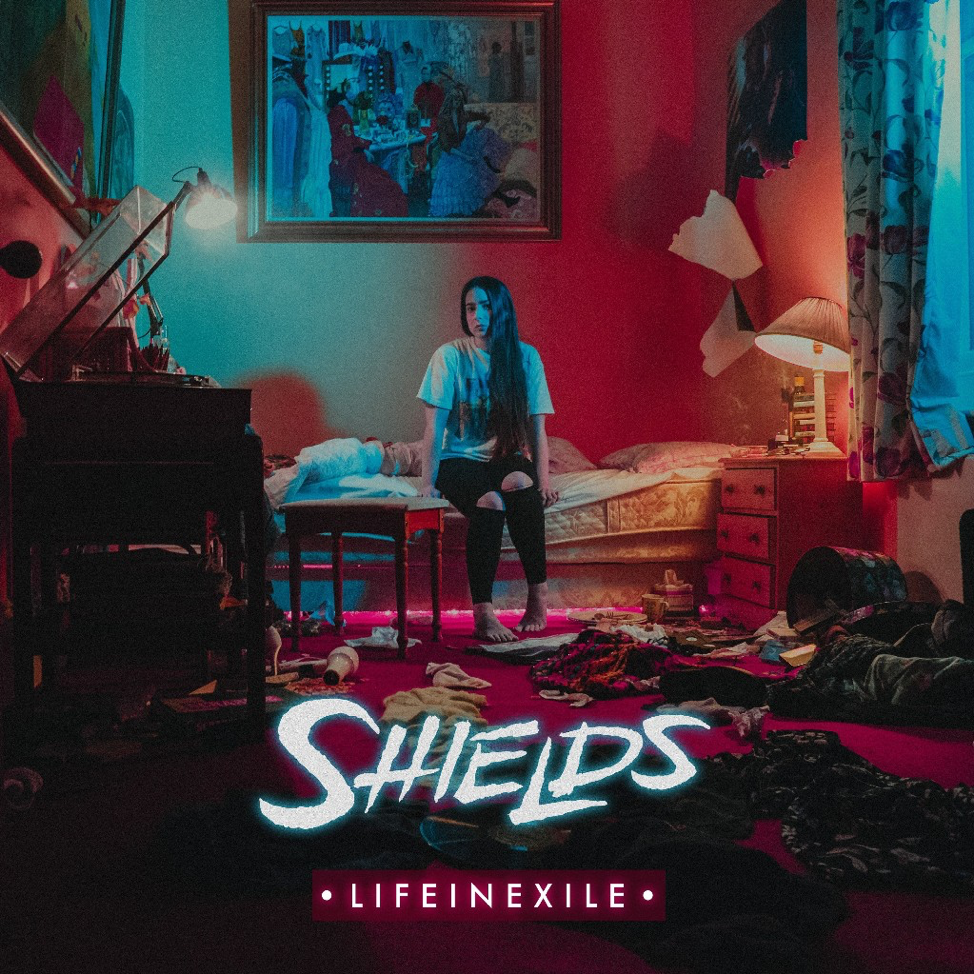 "Today  SHIELDS  released the video for their second single named  ""Black Dog""  from their upcoming album  ""Life In Exile"".  The artwork for  ""Black Dog""  as well as the video honors George Christie, the guitarist of the band, who passed away in January.  Watch the video  HERE .  Pre-orders for the band's debut album  ""Life In Exile""  are available  HERE .   Shields  are a London-based metal band established in 2012. They wrote and self-released their first EP in 2013 and begun touring the UK relentlessly gathering a strong following wherever they went. In April 2015  Shields dropped their second EP  ""Guilt""  which for the next two years would take them on tours running laps around Mainland Europe and the UK; and land them festivals and shows with the likes of  Born Of Osiris, Chelsea Grin, Ice Nine Kills and Veil Of Maya to name a few. During their extensive touring schedule, the band were writing on and off the road for their next release. Soon after this the band signed to  Long Branch Records  in 2018 and will release their first full-length album  ""Life In Exile "" on April 20th! 2018 is set to be  Shields'  biggest year to date."
