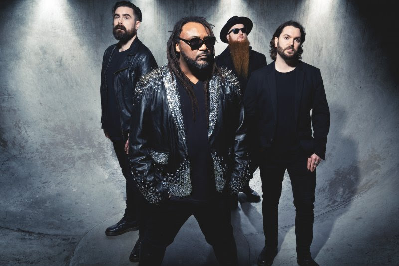 "The day has arrived and the new album  ""Big Tings""  from Skindred is finally released today.The record can be purchased  HERE .    Don't forget to watch the awesome new video for the song  ""That's My Jam""   HERE .    ""That's My Jam""  is an infectious metal pop beast of a track which still retains the Skindred ragga swagga metal trademark sound of the band.     The reception to  "" Big Tings ""  has been nothing short of amazing, as the album has received critical acclaim worldwide:    ""At a time when bands are making cookie-cutter songs, Skindred's style is unique and cuts through. Hands down the most entertaining live band in music""   - Ross Mahoney KXTE Las Vegas -    Expect some big riffs and even bigger hooks.   - Metal Injection -    Super catchy.   - Metal Sucks -    Big Tings is big: it is a massive sound, a bold statement from these seasoned musical veterans.   - Cryptic Rock -    (It) is impossible not to get stuck in your head.   - Metal Wani -    Each of these tracks are bangers, deserving of heavy airplay.   - Exclaim -    Combined with some of the most energetic live shows this side of Airbourne, Skindred seem set to conquer the world.   - Exclaim -    Big Tings' songs are full of solid guitars and some big riffs from Mikey Demus, all complimented by Arya Goggins' punchy drums and the almighty Benji Webbe's extreme range of vocal styles.   - Pure Grain Audio -    Big Tings … is straight up fiyah!   - Skulls n Bones -    They return with their seventh album and […] 10 superb tracks.   (4/5)   - Buzz Magazine -    New album 'Big Tings' is probably the most accessible the band have created thus far.   (9/10)  -Powerplay -    It's A Corker!   (4/5)  - Weekend Sport -     Welsh Raggar-Metallers return with searing seventh album.   (4/5)  - Planet Rock -"