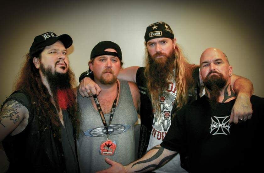 Chad Lee with The Triple Threat - Dimebag, Kerry King & Zakk Wylde  Iconic rock photographer Chad Lee has been working in the music industry for 20 years. During that time, he has photographed many notable rock acts such as  Dave Mustaine , Zakk Wylde , Dimebag Darrell , Pantera , David Draiman , Disturbed , Slayer , KISS , Testament , REX , Puddle Of Mudd , Anthrax , Whitesnake , The Dead Daisies , Rob Zombie , Black Label Society , Soil , Shadows Fall , In This Moment , Devildriver , Black Sabbath , Alice In Chains , Megadeath , and  Lynyrd Skynrd , to name only a fraction of his work. In fact, you have probably seen his work without even realizing it!