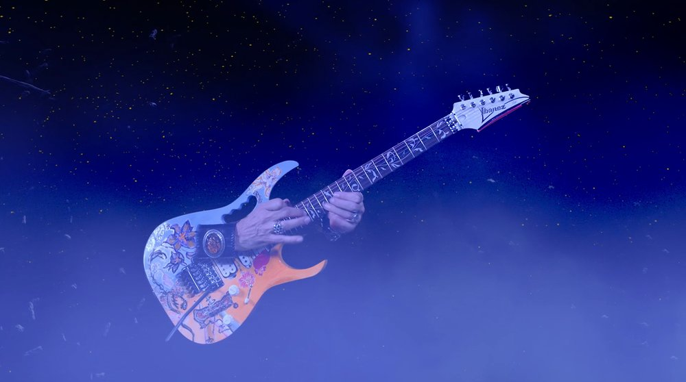 "Los Angeles, CA — Steve Vai has released a music video for ""Dark Matter"" via his Official YouTube Channel SteveVaiHimself today. View the video here:  https://youtu.be/4aINCu8CoTA  Vai teamed with Blackmagic Design, Moai Films and director Lukas Colombo on the video, with Moai Films producing. ""Dark Matter"" is one of the songs from  Modern Primitive,  a collection of previously unreleased material delivered in tandem with  Passion and Warfare 25th Anniversary Edition  by Sony Music Entertainment and Legacy Recordings.  The ""Dark Matter"" video was shot entirely on green screen utilizing a full Blackmagic Design pipeline, including editorial, visual effects using URSA Mini Pro and finishing in DaVinci Resolve 15. Blackmagic Design, with offices in USA, UK, Japan, Singapore and Australia, creates the world's highest quality video editing products, digital film cameras, color correctors, video converters, video monitoring, routers, live production switchers, disk recorders, waveform monitors and real time film scanners for the feature film, post production and television broadcast industries.  Long known as one of the top guitarists in the world, Vai has won three Grammy Awards and worked with artists such as Frank Zappa, David Lee Roth, Whitesnake, and a myriad of others. Vai's  Passion and Warfare  album is considered one of rock's landmark albums.  In producing his newest music video, Vai wanted to do something special. ""I wanted to create something that not only looked other worldly, but was also shot uniquely as well,"" Vai said. ""The idea was to create an alien type landscape where each band member was filmed at a different speed and then brought together in various shots. I had to learn the song backwards! There are all these little complexities, which is a fun challenge, but it's almost like wearing a straight jacket and trying to run a forward marathon with eyes only in the back of your head.""  Moai Films brought in VFX Supervisors Bruce Jergens and Nick Torres to help guide the design. The VFX team combined 2D and 3D elements to create the unique environments. ""We wanted to have a completely alien environment,""said Torres, ""with tall spires as mountains and a glassy still ocean with a fast rolling fog on top.""  Vai, who hosted the Big Mama Jama Jamathon — a 53 1/2-consecutive-hour event at Musicians Institute in Hollywood to benefit non-profit foster care and adoption agency Extraordinary Families — with guests such as Dave Navarro, Moby, Orianthi, Al Di Meola and Dweezil Zappa, Sept. 28-30 will continue to have a busy fall season. Vai will perform his own compositions with the Alabama Symphony Orchestra (Carlos Izcaray, Conductor) in Birmingham, AL at UAB's Alys Stephens Center on Nov. 2, before joining Zakk Wylde, Yngwie Malmsteen, Nuno Bettencourt, and Tosin Abasi in the supergroup Generation Axe for a 32-date tour of North America, beginning November 7 at the Fox Theater in Oakland, CA.  ""The Generation Axe show is a unique performance of five fiercely talented guitar players coming together to create a 6-string extravaganza that is sure to amaze and delight,"" Vai said.  Each Generation Axe tour stop will include a variety of collaborations by the five players, including everyone performing together as one cohesive band with a rhythm section including Pete Griffin (Dweezil Zappa, Stanley Clarke, Edgar Winter) on bass, Nick Marinovich (Yngwie Malmsteen) on keys, and JP Bouvet on drums. Vai, Wylde, Malmsteen, Bettencourt and Abasi will perform songs from their various catalogs and join forces on some well-known songs (as well as probably a few unexpected, unearthed gems). Special VIP packages are available. For more information:  www.generationaxe.com   Fans can pre-order Generation Axe's forthcoming release,  The Guitars that Destroyed the World: Live in China  on CD and vinyl, along with autographed copies, signed guitars, merch bundles and much more at https://www.pledgemusic.com/projects/generation-axe   Vai has also spearheaded a fundraiser through PledgeMusic benefitting Los Angeles-area foster children non-profit Extraordinary Families with exclusive merchandise and signed CDs. This is an extension of Vai's Big Mama Jama Jamathon held in Hollywood, CA Sept. 28-30. More info at  https://www.pledgemusic.com/projects/steve-vai-jamathon-2018   Confirmed Generation Axe appearances include:  11/07 Oakland, CA Fox Theater  11/08 Anaheim, CA City National Grove  11/09 Las Vegas, NV The Joint at Hard Rock Hotel & Casino  11/10 Tempe, AZ Marquee Theatre   #  11/11 Albuquerque, NM El Rey Theater  11/13 Denver, CO Paramount Theatre – Denver  11/15 Kansas City, MO Uptown Theatre  11/16 Salina, KS The Stiefel Theatre  11/17 Tulsa, OK Brady Theater  11/18 Des Moines, IA Hoyt Sherman Theatre  11/19 Cincinnati, OH Taft Theatre  11/20 Grand Rapids, MI 20 Monroe Live  11/21 Detroit, MI Fillmore Detroit  11/23 Medford, MA The Chevalier Theater  11/24 Niagara Falls, NY The Rapids Theatre  11/25 Kitchener, ON Centre in the Square  11/27 Bethlehem, PA Sands Bethlehem Event Center  11/28 Port Chester, NY Capitol Theatre  11/29 Albany, NY The Palace Theatre  11/30 Atlantic City, NJ Hard Rock Hotel & Casino Atlantic City – The Theater  12/01 Rochester, NY Kodak Center for the Arts  12/03 Greensburg, PA The Palace Theatre  12/04 Westbury, NY NYCB Theatre at Westbury  12/05 Richmond, VA The National  12/08 Atlanta, GA Tabernacle  12/09 Orlando, FL Hard Rock Live  12/10 Hollywood, FL Hard Rock Live at Seminole Hard Rock Hotel & Casino  12/11 Clearwater, FL Ruth Eckerd Hall  12/13 Austin, TX The Moody Theater  12/14 Dallas, TX The Bomb Factory  12/16 Salt Lake City, UT The Complex – Rockwell  12/18 Los Angeles, CA The Wiltern   # - Nuno Bettencourt not appearing"