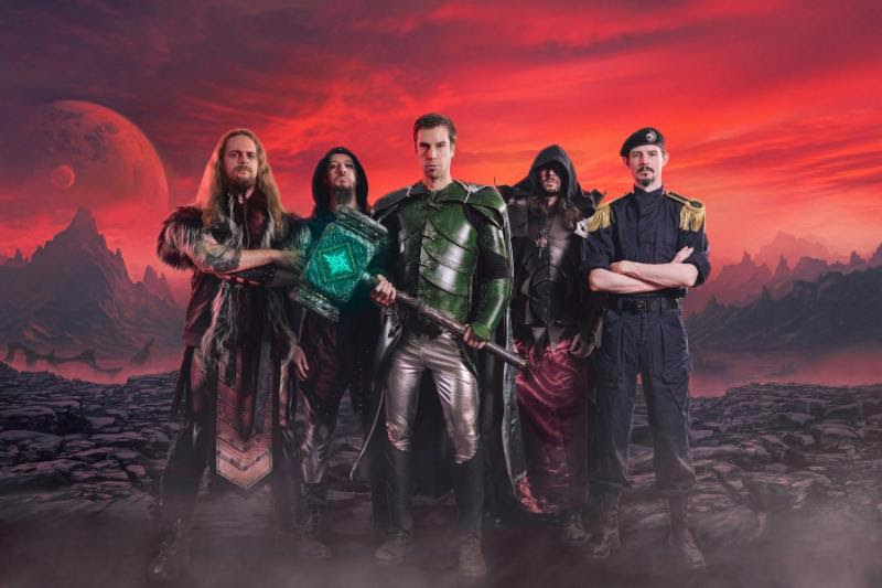 """[Photo Credit: Robert Zembrzycki]   Wielding steel that is true Since 1992 For the King of Dundee, my destiny Glory! Hammer!   Symphonic power metal purveyors GLORYHAMMER have released the first single and official music video cut from their highly-anticipated third studio album  Legends from Beyond the Galactic Terrorvortex  - out May 31, 2019 via Napalm Records.Pre-orders for  Legends from Beyond the Galactic Terrorvortex  are now available HERE .   On their 2013 debut album,  Tales from the Kingdom of Fife  , GLORYHAMMER 's story began with the tale of an alternate-history medieval Scotland - a realm of dragons, wizards, magic and dark sorcery. The story tells the legend of the glorious hero Angus McFife XIII, who wages a long war against the evil sorcerer Zargothrax, in order to free the people of Dundee!  In this latest installment of the GLORYHAMMER story, the galaxy waits in fear for the return of Angus McFife XIII, who fought the greatest battle the galaxy has ever heard of, against Zargothrax. All hope of the Kingdom of Fife lies in the strong arms and the infinite wisdom of their young prince.  For  Legends from Beyond the Galactic Terrorvortex  , the five heroes around Angus McFife XIII created the galactic hymn, """"Gloryhammer"""" , which tells the story about their own journey through time and space, the greatest battles of all times and neverending glory.   Listen to the new single   HERE   !   Christopher Bowes says about the track """"Gloryhammer"""" : """"Mighty warriors of the galaxy! Are you ready to raise up your laser powered goblin smasher to defeat the forces of Zargothrax? Then it's time to watch the video for our new single... simply called   """"Gloryhammer""""   ! In this song, Angus McFife has arrived into a terrible alternate universe ruled by the evil wizard Zargothrax... and to make matters worse, his legendary Hammer of Glory is powerless! His only hope is to fly into space and recharge the hammer with the power of astral fire... if his quest fails, then"""