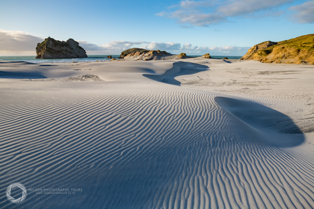 Sand patterns  on Wharariki Beach enhanced in late afternoon light.