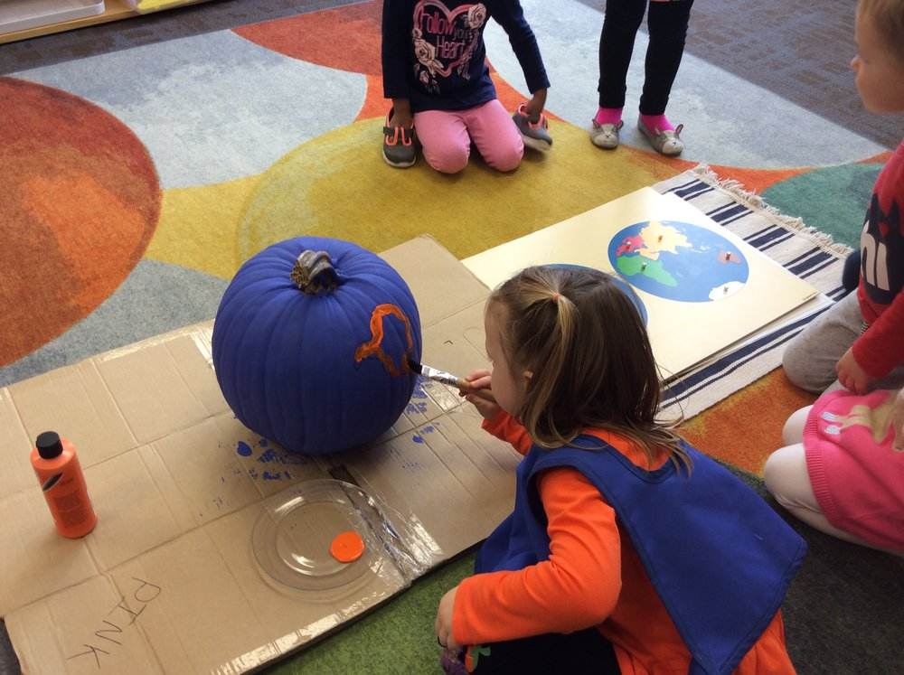 Preparing a pumpkin globe for our event
