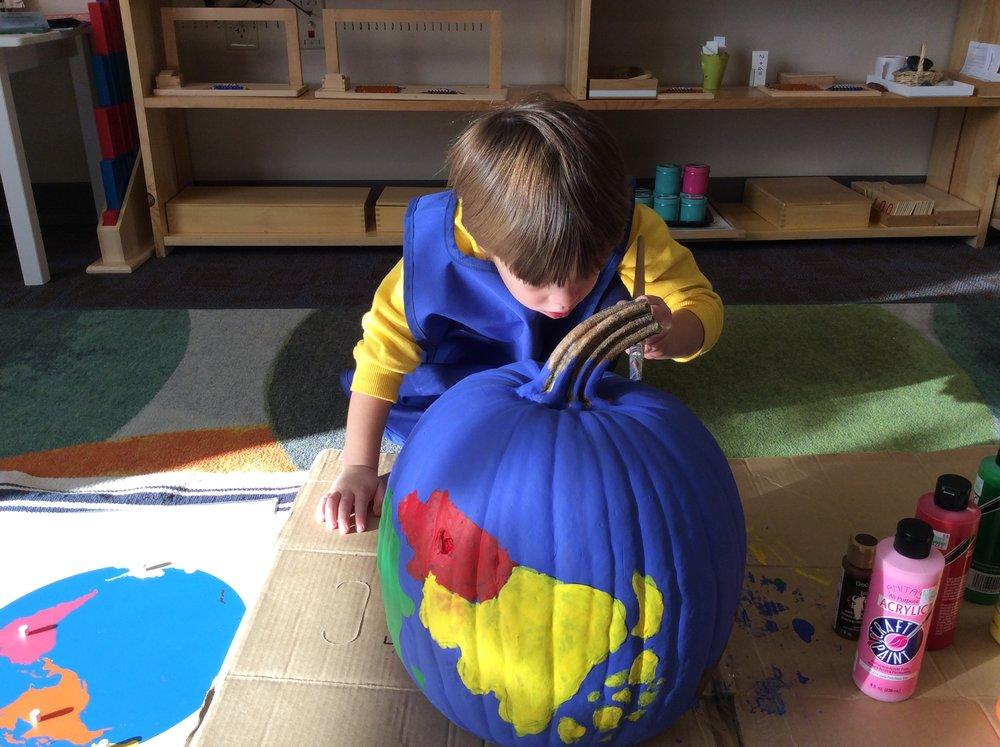 Preparing a pumpkin globe for our event!