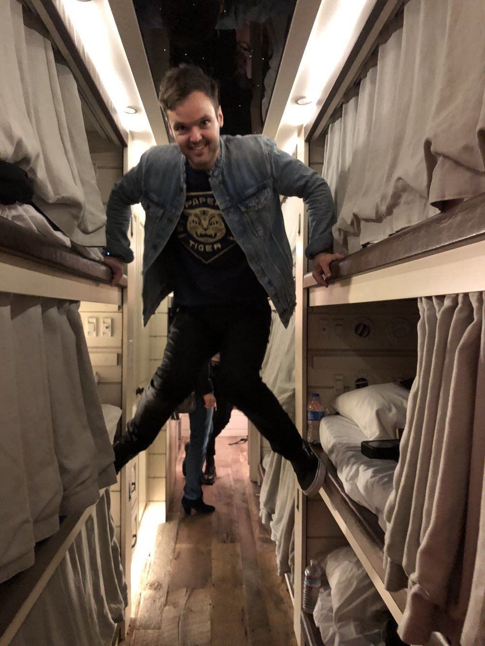 "Goofing around on their tour bus. ""This is how you get to the top bunk!"""