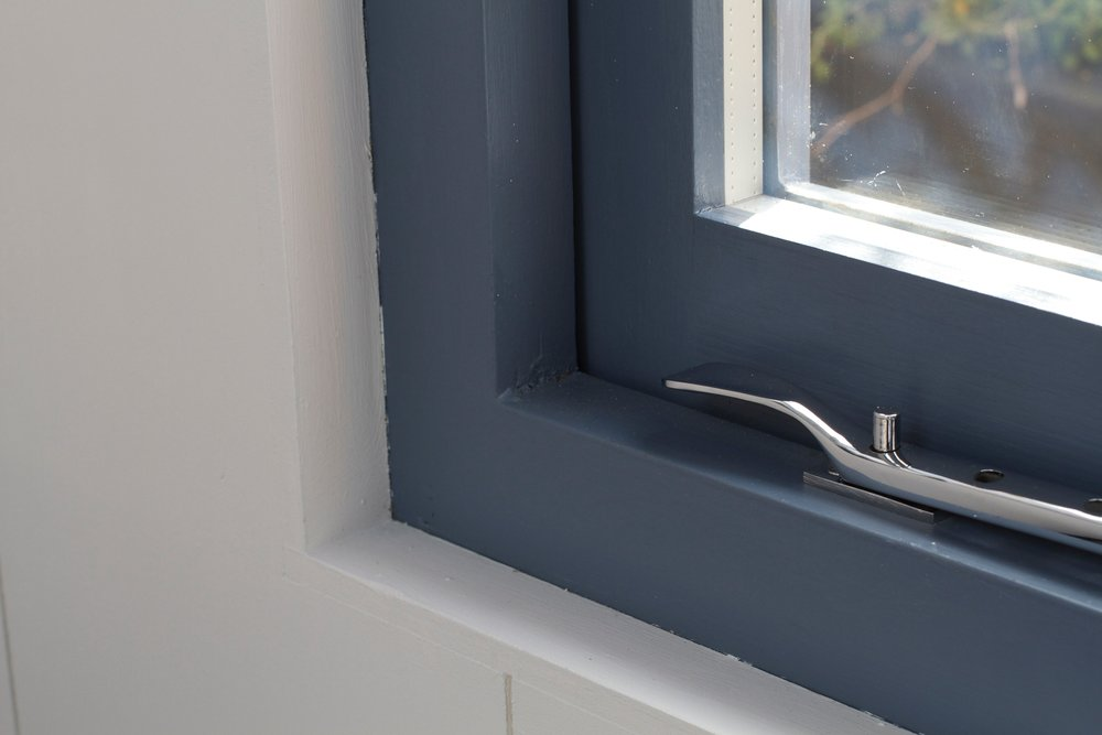 Spacetwo Studio window painted in Juniper Ash and woodwork painted in Gauze by Little Greene Paint Company
