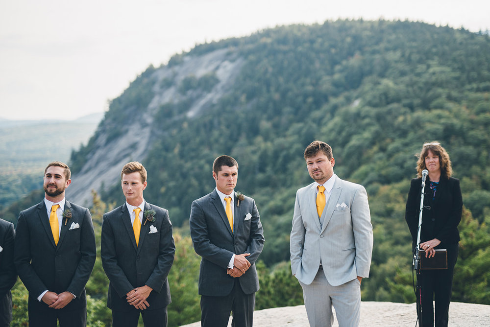 Gray and yellow groom suit and gray and yellow groomsmen suits.Mountain and forest DIY wedding.