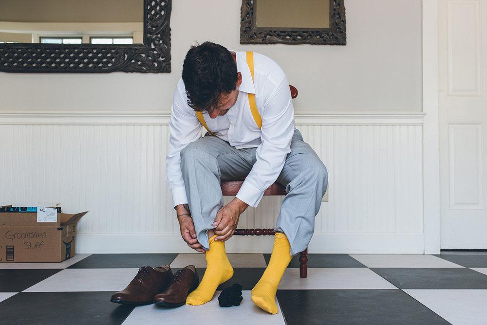 Yellow groom and groomsmen socks. Yellow groom suspenders.Mountain and forest DIY wedding.
