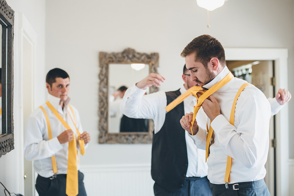 Yellow groomsmen ties. Yellow groomsmen suspenders. Mountain and forest DIY wedding.