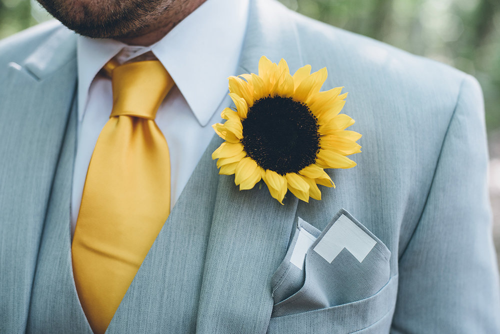 Sunflower groom boutonniere. Mountain and forest DIY wedding.