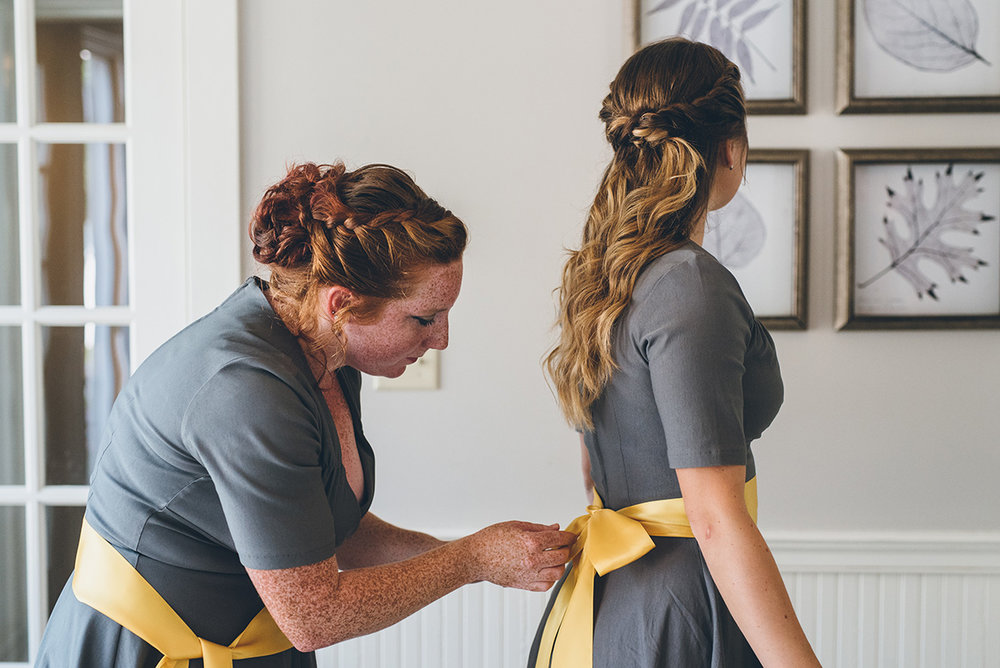 Yellow and gray bridesmaids sashes.Mountain and forest DIY wedding.