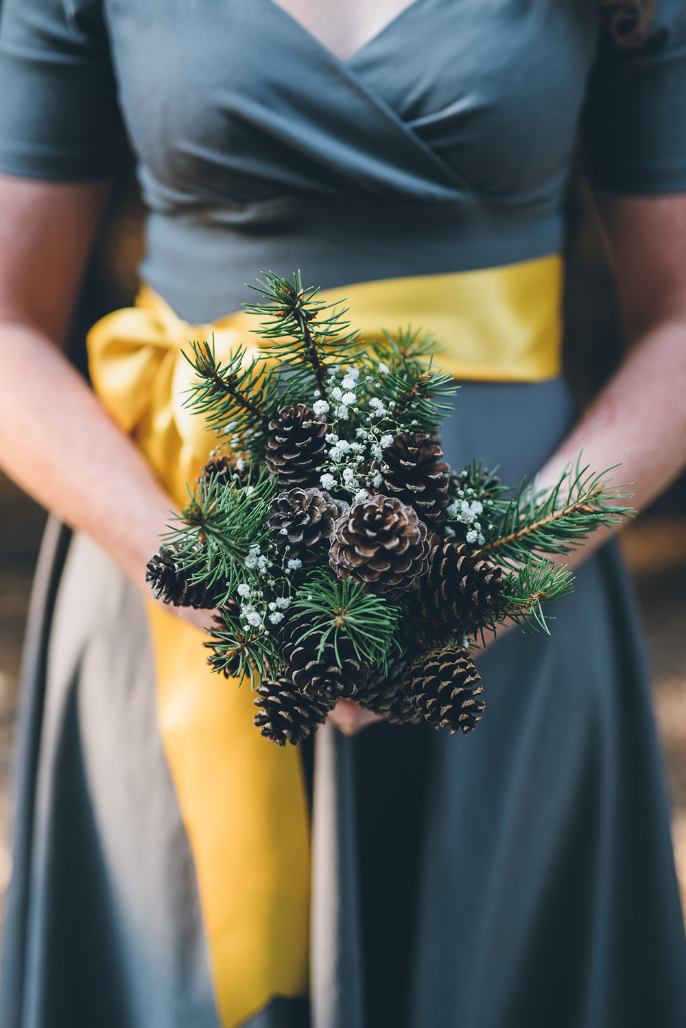 Pinecone bridesmaids bouquet. Mountain and forest DIY wedding.
