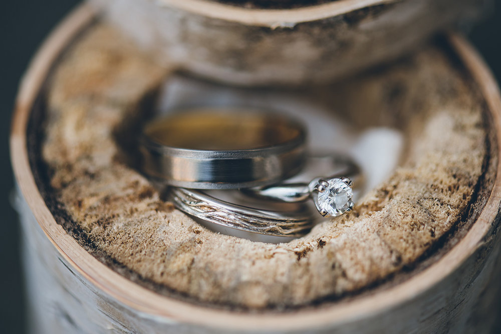 Birch tree wedding bands with the inner bands lined with a tree from our land. Mountain and forest DIY wedding.