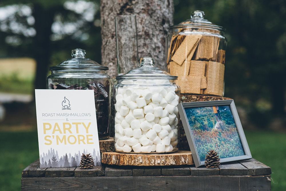 Wedding s'more's bar for camping wedding. Mountain and forest DIY wedding.