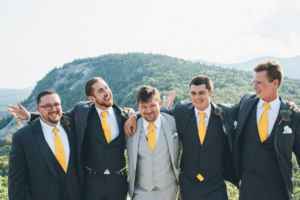 Gray and yellow groomsmen suits.Mountain and forest DIY wedding.