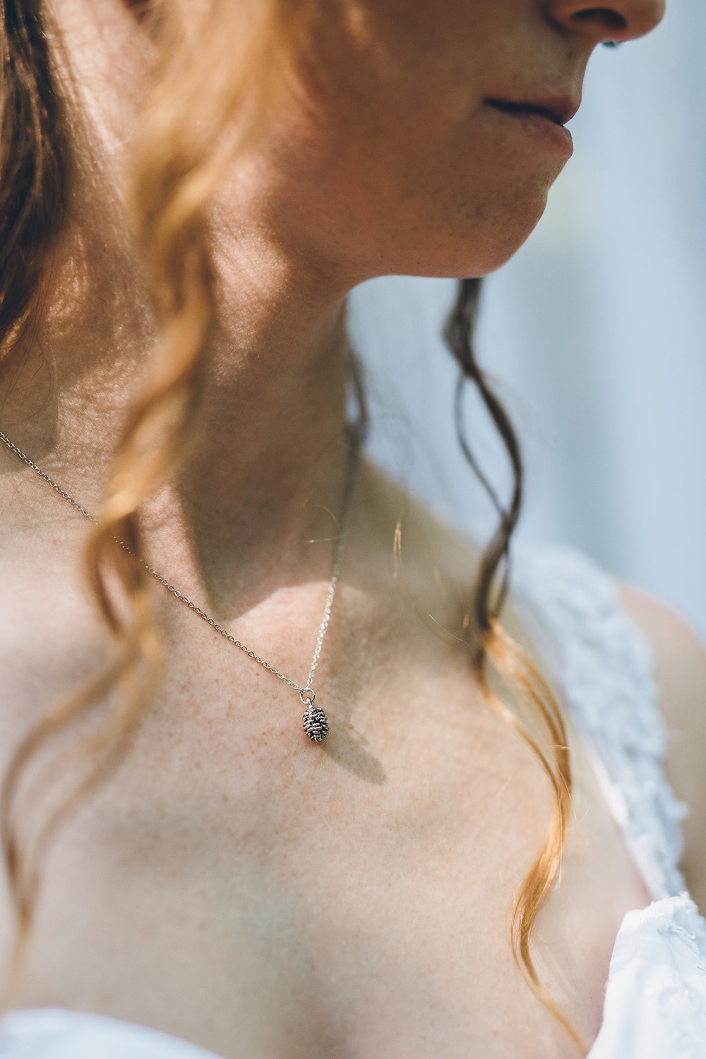Pinecone necklace for the bride. Mountain and forest DIY wedding.