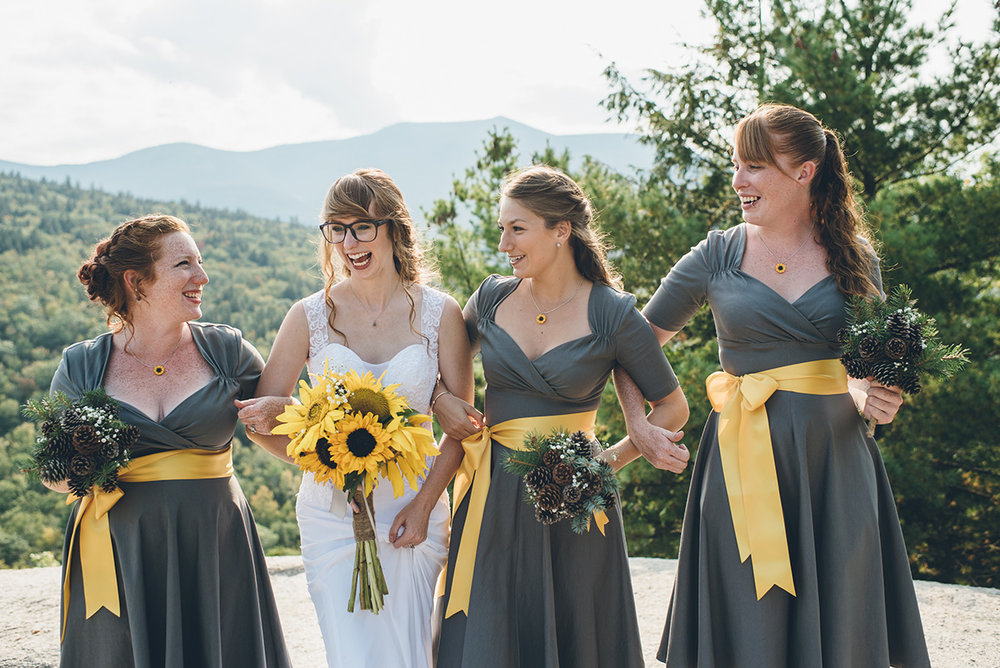 Gray and yellow bridesmaids dresses. Bride wearing glasses. Wedding glasses.