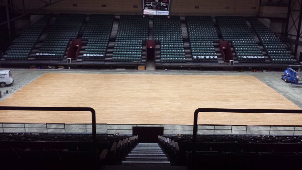 DeltaPlex Arena - Sanded the old amber finish off & ready for game lines.