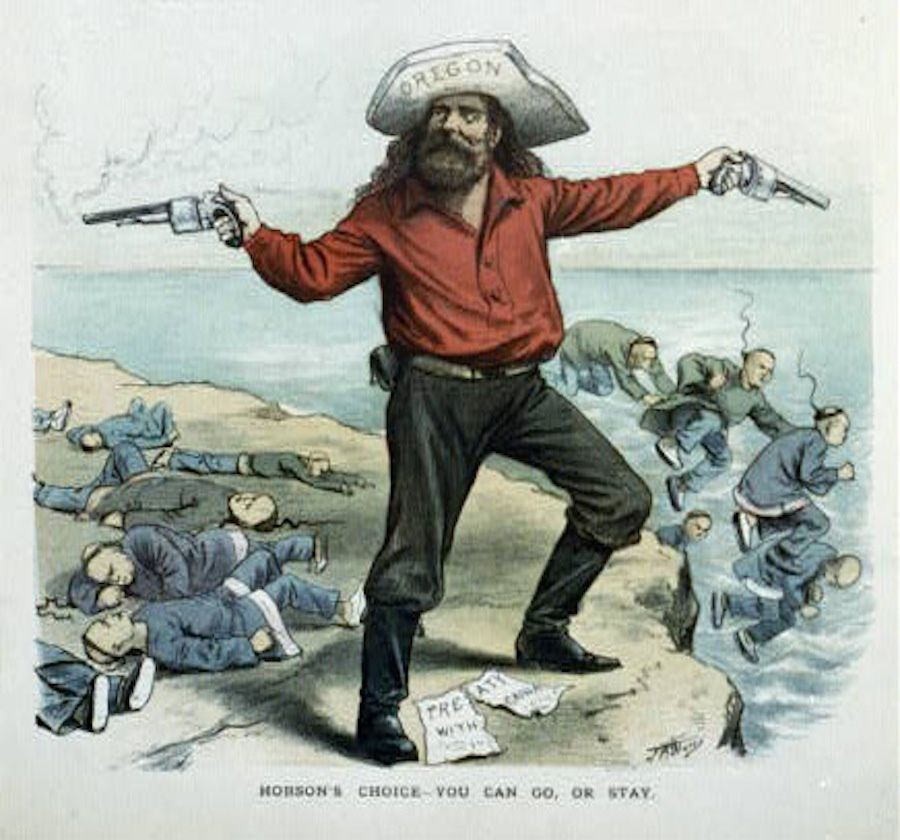"An Oregon man stands on a cliff with a torn ""Treaty With China"" on the ground. (Creative Commons)"