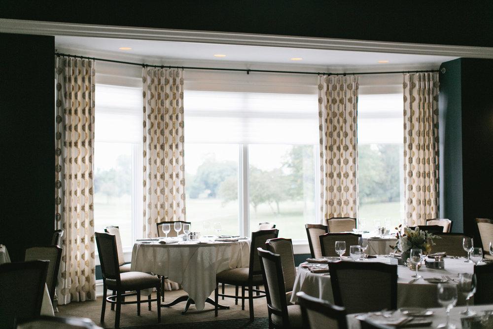 Custom designed window draperies and sheers