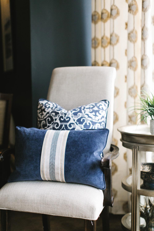 Soft sunlight through window treatment onto custom pillows