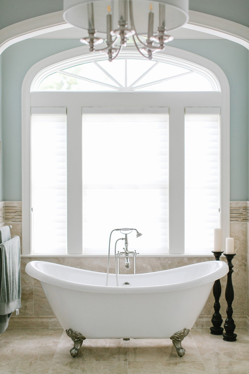 Custom window treatments in bathroom remodel
