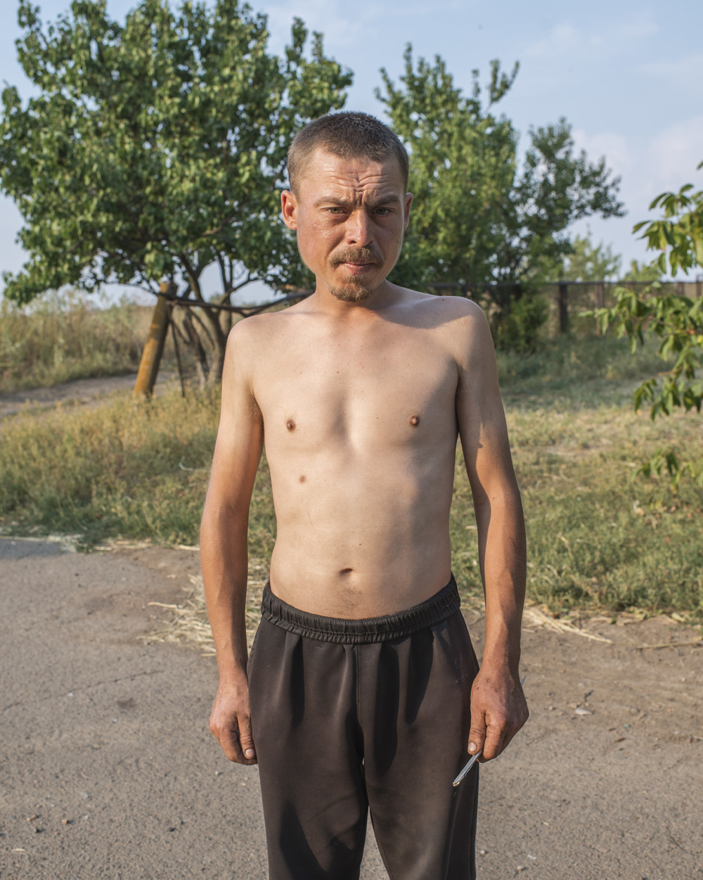 """Leonid, 26, Anatol. """"If the shelling comes here we can do nothing, it's heavy artillery you can't really hide."""""""