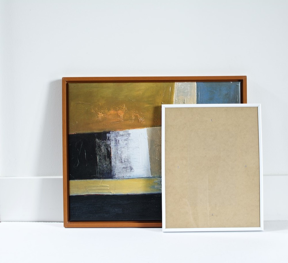 thrift store white frame: $2