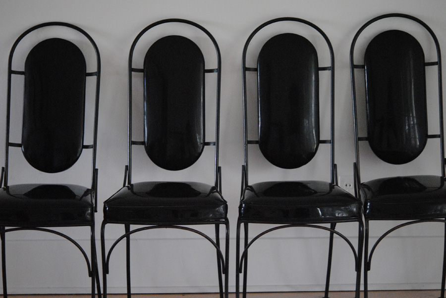 Mid century black iron and vinyl dining chairs