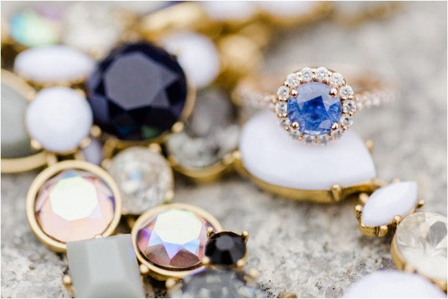A sapphire and rose gold engagement ring photographed by Deborah Zoe Photography.